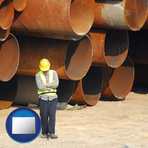 a municipal engineer with iron sewer pipes - with Colorado icon