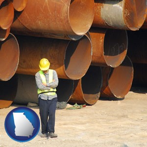 a municipal engineer with iron sewer pipes - with Georgia icon