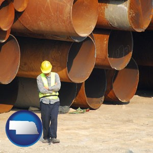 a municipal engineer with iron sewer pipes - with Nebraska icon