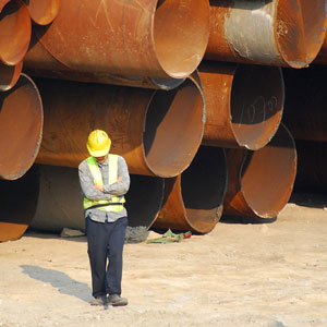 a municipal engineer with iron sewer pipes